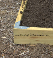 using a bracket for a raised bed