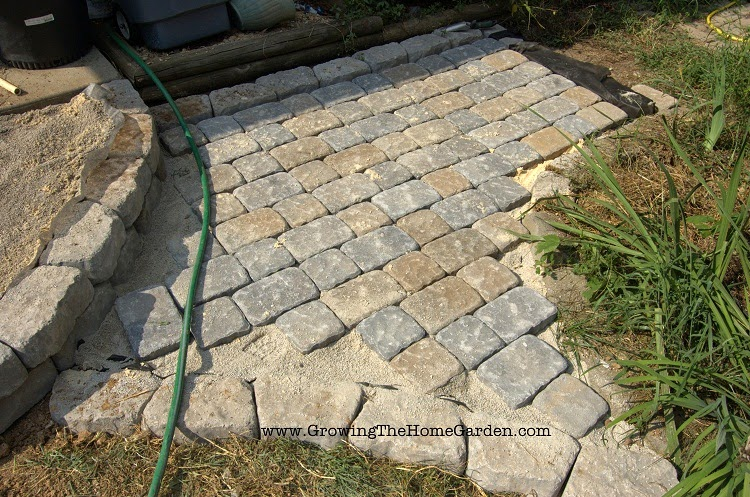 Using paving stones to build a pathway, patio, or sidewalk.