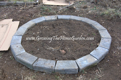 circular raised bed garden with retaining wall blocks