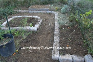 Raised Bed Vegetable Garden with Stone Borders