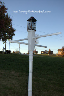 A Light post, Bird Feeder Station, and Hanging Basket Stand all in One!