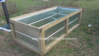 Making a raised bed from metal roofing materials growing the home garden for Best material for raised garden beds